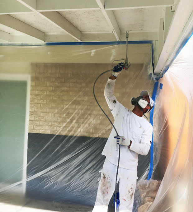 denver painter spraying a roof
